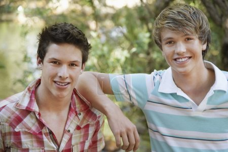 Young Male Friends Smiling