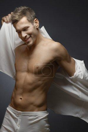 Happy Man Putting On Shirt