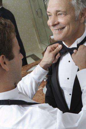 happy senior man with bow tie