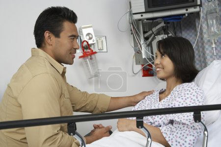 Man Comforting Female Patient