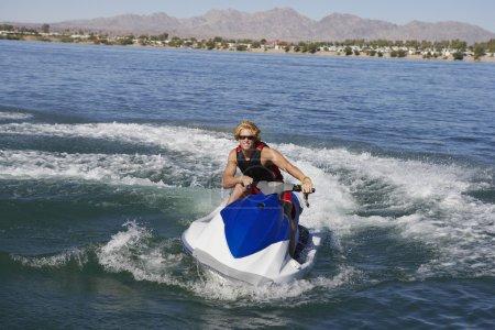 Man Riding PWC On Lake