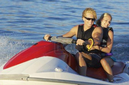 Couple Riding PWC