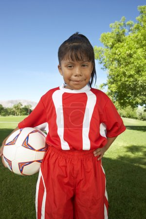 Girl Standing With Soccer Ball