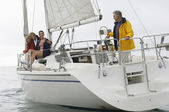 Family Sailing On Boat During Vacations