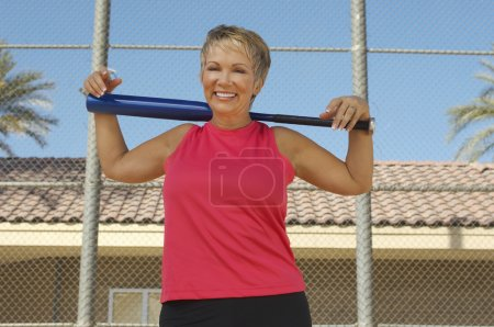 Photo for Portrait of happy Caucasian woman holding baseball bat on shoulder - Royalty Free Image