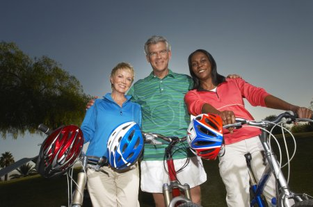 Multiethnic Friends Standing With Bicycles