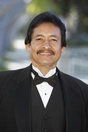 Hispanic Man In Tuxedo At Quinceanera