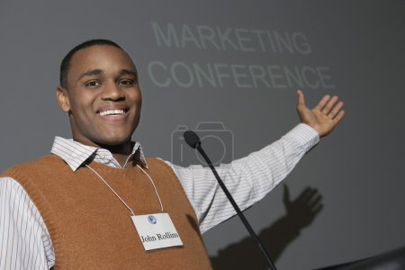 Businessman Giving Presentation At Conference Meeting