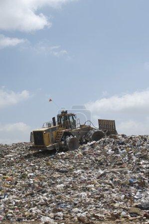 Excavator At Dumping Ground