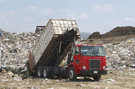 Truck with garbage at dump