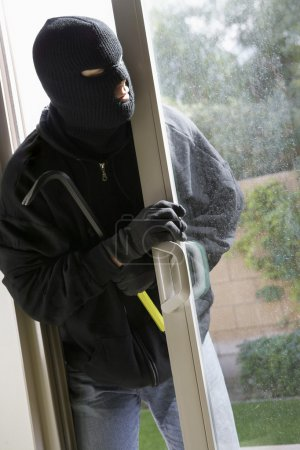 Burglar Breaking Into House
