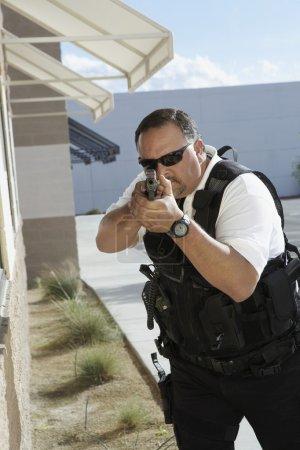 Security Guard Aiming With Gun
