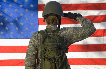 Soldier Saluting In Front Of American Flag