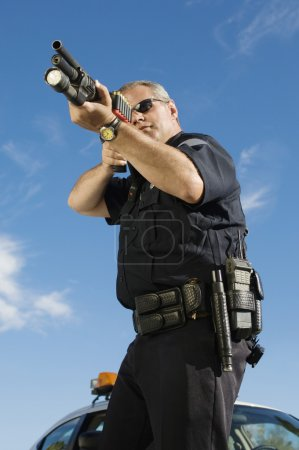 Police Officer With Gun