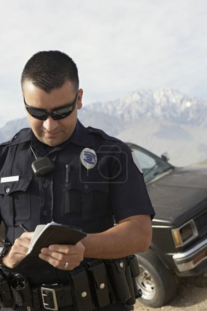 Police Officer Taking Notes