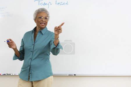 Senior teacher explaining in the classroom