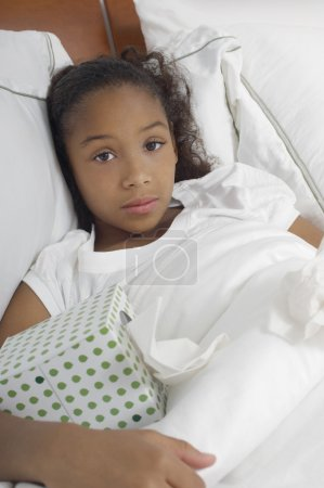 Girl With Tissue Box In Bed