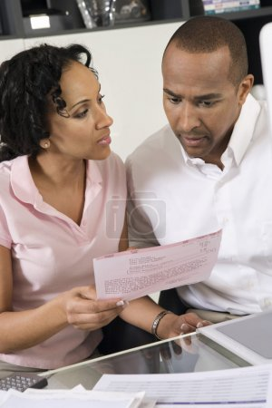Couple Discussing A Bill