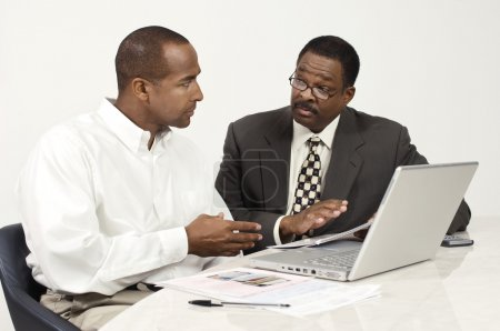 Photo for African American business in meeting at office desk - Royalty Free Image