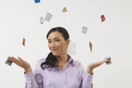 Woman Throwing Away Credit Cards