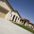 Tilt image of new house with large garage and arch...