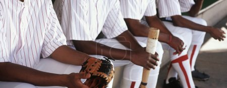 Baseball Players Sitting Together In Dugout