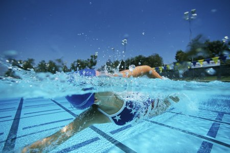 Photo for Young female swimmer swimming in pool - Royalty Free Image