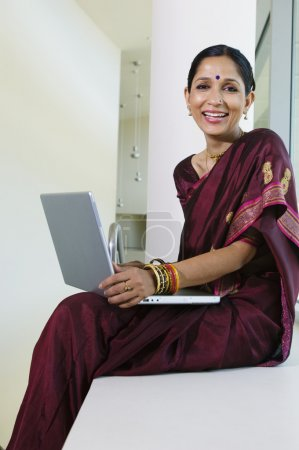 Indian Businesswoman Working On Laptop