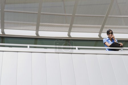 Woman On Call At Office Balcony