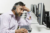 Stressed Customer Service Operator On Call