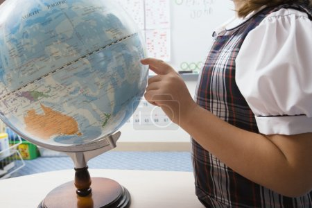 Little Girl Pointing to Globe