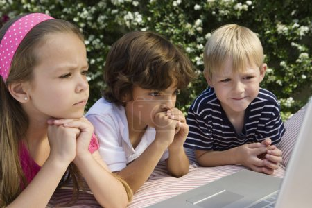 Concerned kids with laptop