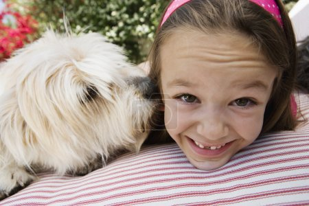 Happy girl with pet dog