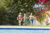 Happy kids in swimming pool