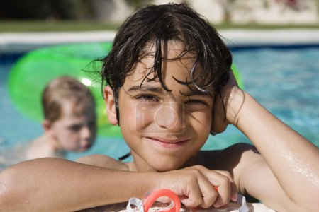 happy little boy in Swimming Pool