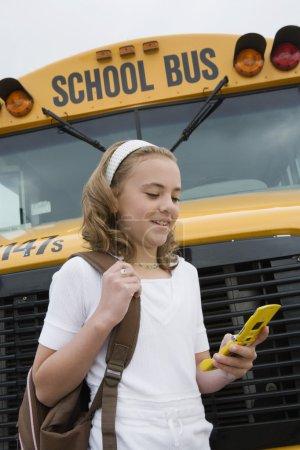 high school student near school bus
