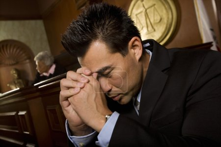Tensed Man Sitting In Courtroom