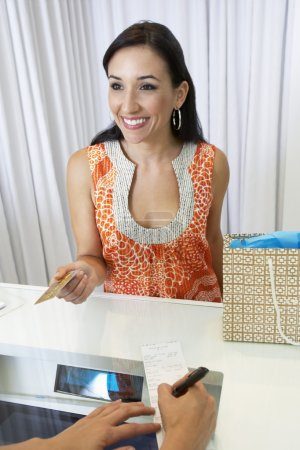 Woman Making A Purchase With Credit Card
