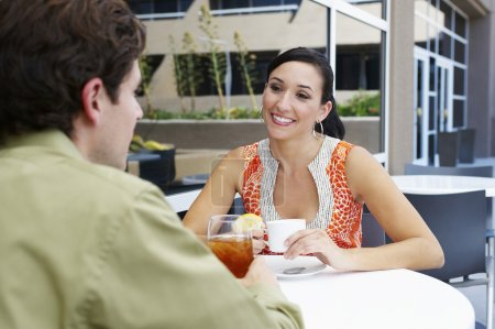 Photo for Beautiful couple on date sitting in a restaurant - Royalty Free Image