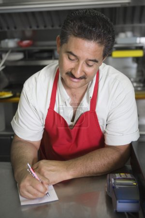 Hispanic Latin man at restaurant counter