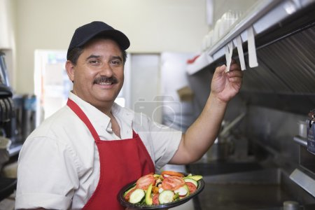 Man In Restaurant Kitchen
