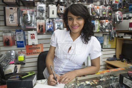 Female Owner Making Bill At Mobile Store