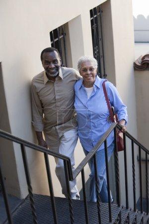 Mature Couple Climbing Stairs