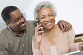 Happy Couple Shopping Online Using Credit Card