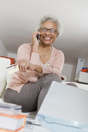 Cheerful Senior Woman On Call