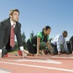 Four multiethnic business at starting blocks...