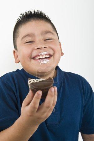 Happy Boy Eating Cookie
