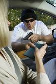 Man Assaults Woman With Firearm Through Car Window