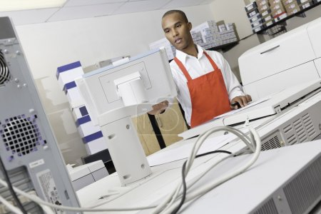 Man operating printing machine