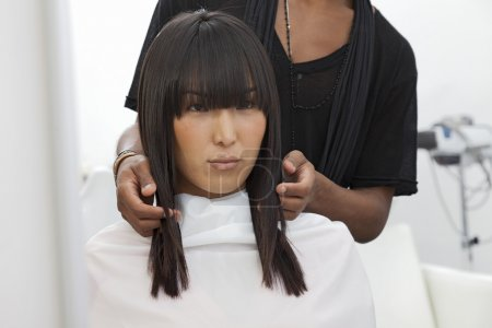 woman getting new haircut